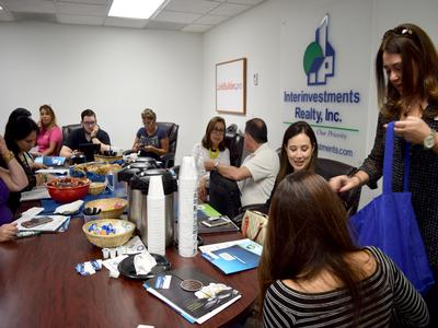 One of the Lennar reps sharing goodies with the team (far right)