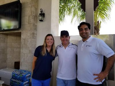 Lorna Scandella (left) and Salman Ali (Right) helping the chef.