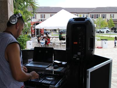 DJ sets the summer vibe for everyone to enjoy.